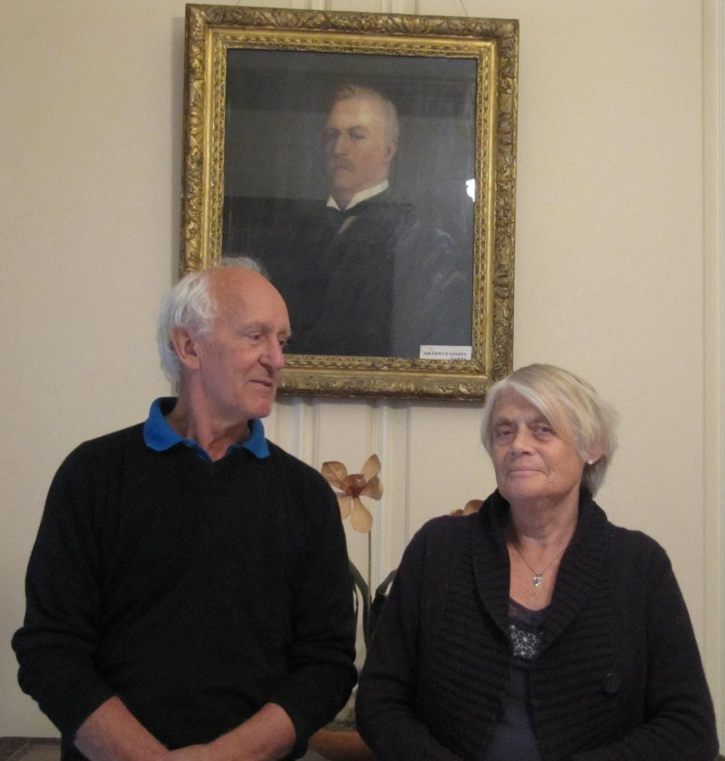 Sandys and Lesley Dawes, sit beneath a picture of 'Sir Edwyn'