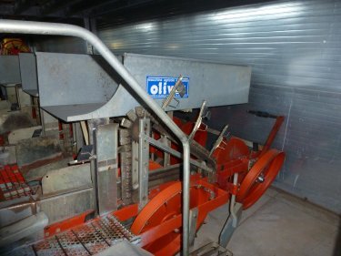 Machine used for planting rootstocks and installing irrigation pipes