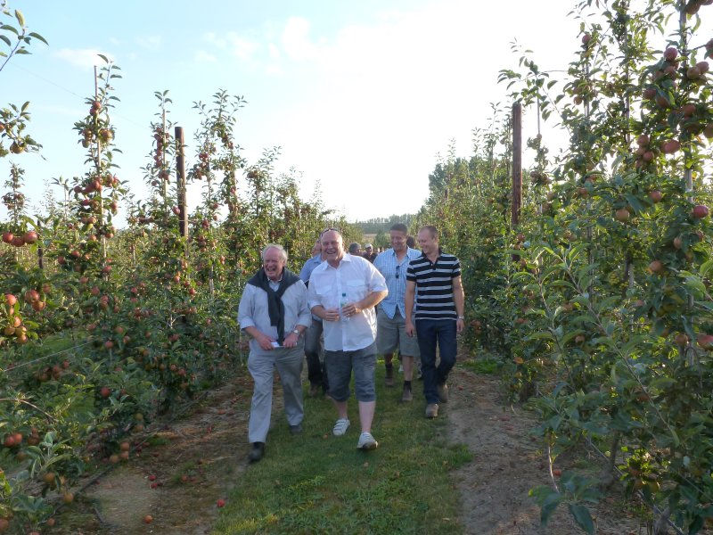 Harry Wooldridge (front left) and Nigel Stewart (white shirt) lead members through Gala orchards at Gore Farm