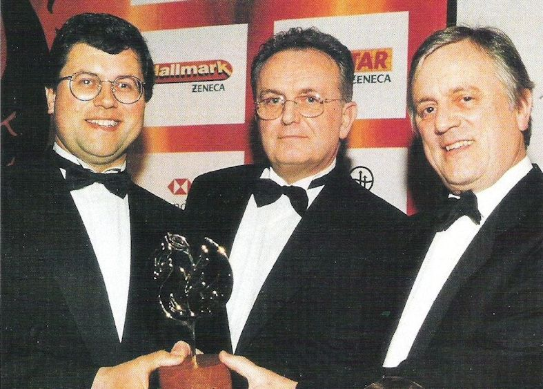 Robert (left) and Ian Mitchell (right) receive the BGLA Grower of the Year Award in 1999.