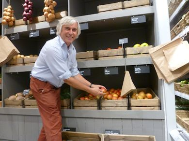 Chris Levett attending to the apples in the produce display