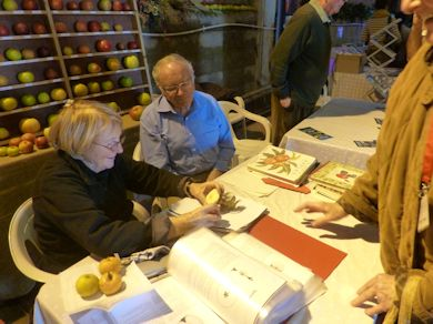 Joan Morgan and Brian Self identify apples for visitors