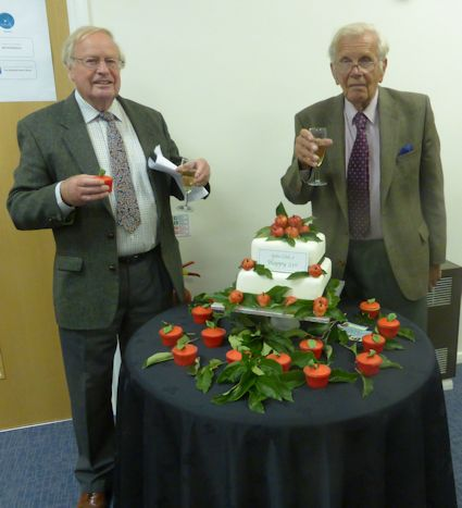 Harry Wooldridge and Roger Worraker pose with the Birthday cake